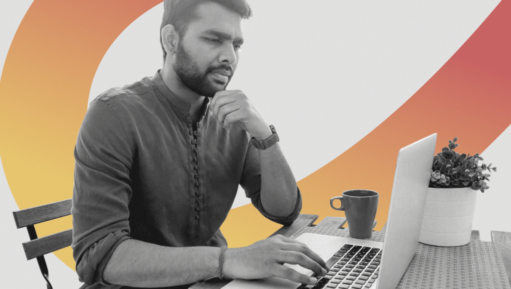 An IT consultant thinking in front of a laptop executing IT consultant job descriptions.