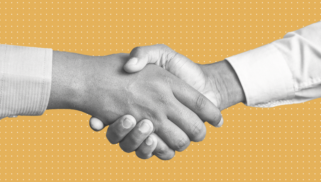 Closeup of people shaking hands after completing the recruitment process.