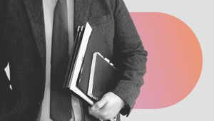 A CEO carries binders and notebooks as part of a CEO's job descriptions and responsibilities.
